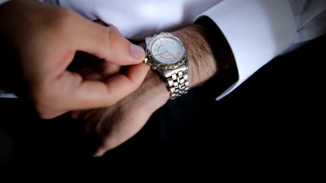 businessman checking the time - elegance stock videos & royalty-free footage