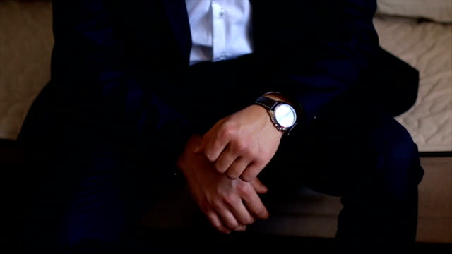 businessman checking time from watch - bossy stock videos & royalty-free footage