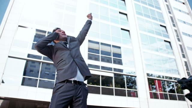 SLO MO Businessman cheering the success