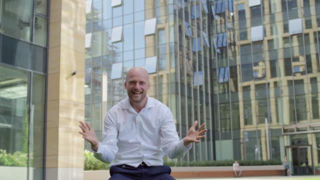 businessman cheering the success - human limb stock videos & royalty-free footage