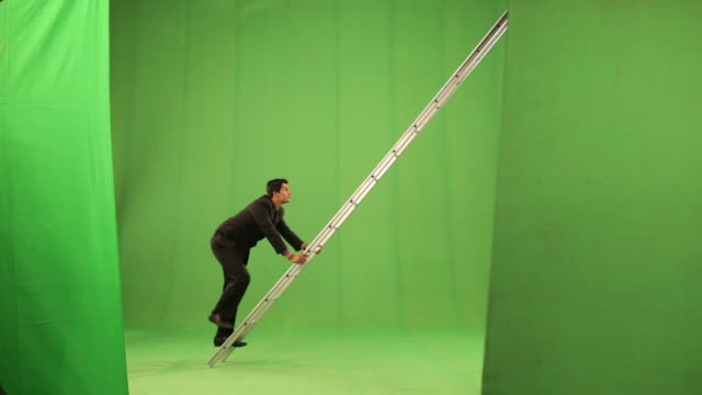 Businessman climbing a ladder