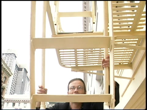 businessman climbing ladder - fire escape stock videos and b-roll footage