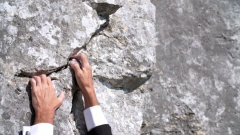 businessman climbing steep mountain - ladder of success stock videos & royalty-free footage