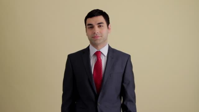 MWS businessman crossing arms  smiling at camera