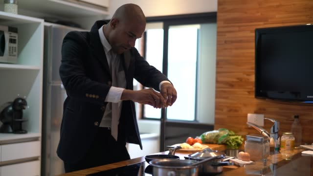 businessman dancing and cooking at home - pardo brazilian stock videos & royalty-free footage