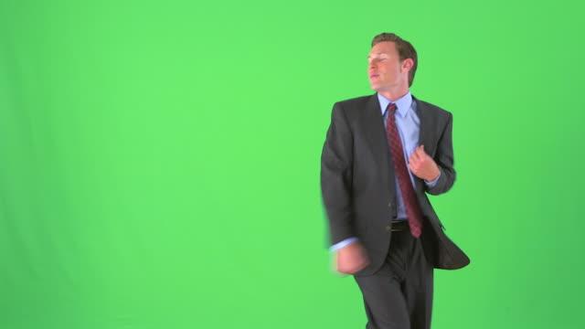 businessman dancing on greenscreen