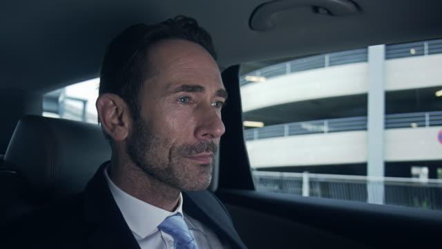 businessman deboarding car - chauffeur stock videos and b-roll footage