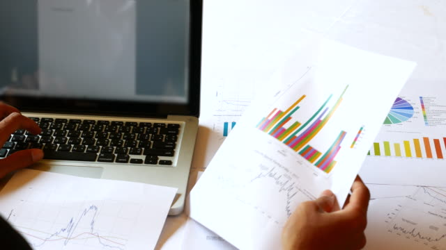 Businessman developing a business project and analyzing market data, 4K(UHD)