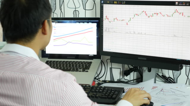 Businessman developing a business project and analyzing market data