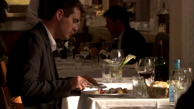 a businessman dines in a fine restaurant. - place setting stock videos & royalty-free footage