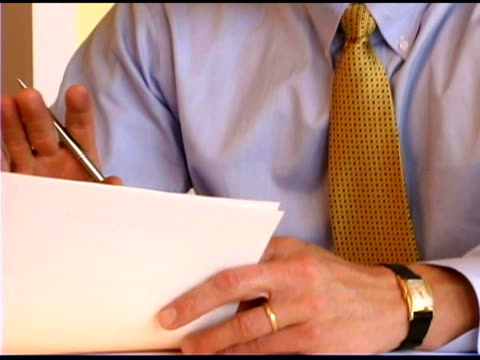businessman discussing paperwork - one mature man only stock videos & royalty-free footage