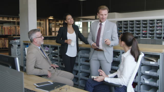 businessman discussing with colleagues in office - 20 seconds or greater stock videos & royalty-free footage