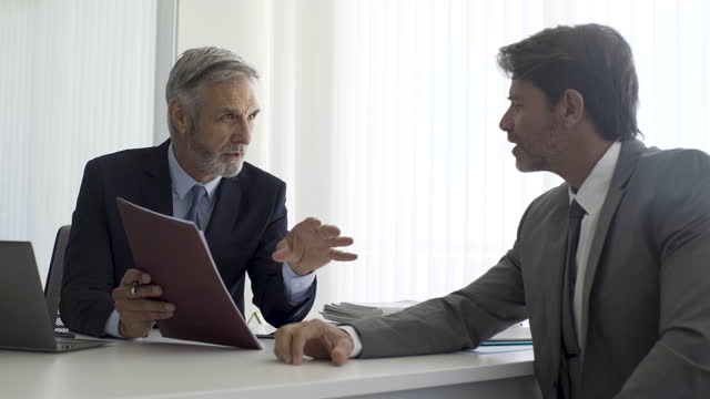 businessman discussing with partner in office - pen stock videos & royalty-free footage