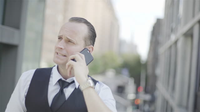 businessman discussing work on cell phone - hochgekrempelte ärmel stock-videos und b-roll-filmmaterial