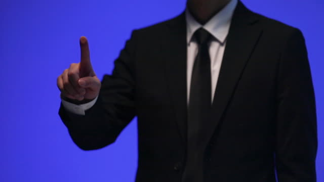 businessman doing touch screen hand gestures on the virtual screen - index finger stock videos & royalty-free footage
