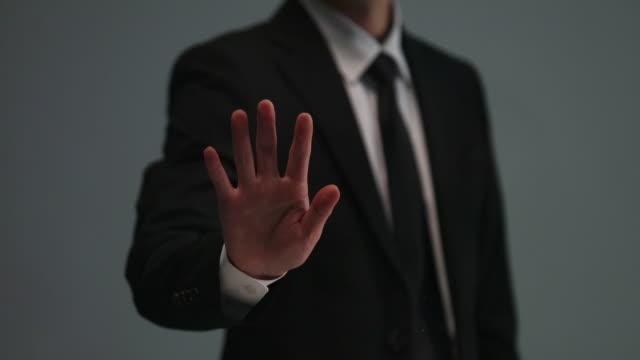 businessman doing touch screen hand gestures on the virtual screen - berührungsbildschirm stock-videos und b-roll-filmmaterial