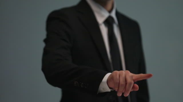 Businessman doing touch screen hand gestures on the virtual screen