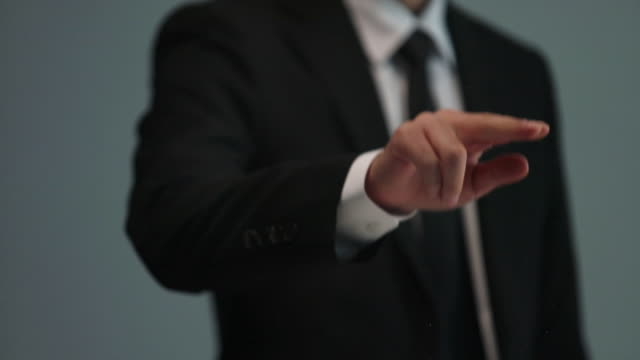 businessman doing touch screen hand gestures on the virtual screen - シャツとネクタイ点の映像素材/bロール