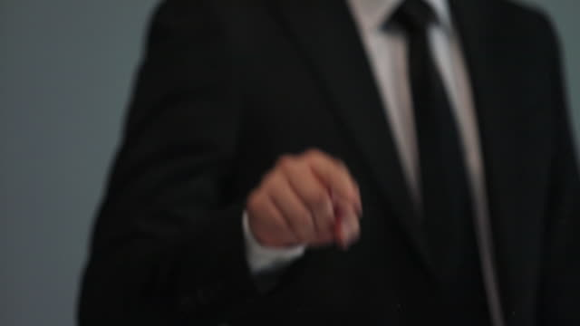 vídeos de stock, filmes e b-roll de businessman doing touch screen hand gestures on the virtual screen - camisa e gravata