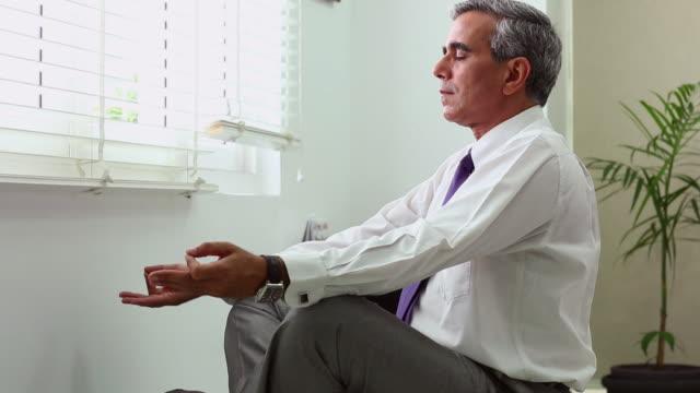 office meditation. Simple Office Businessman Doing Yoga In An Office To Office Meditation