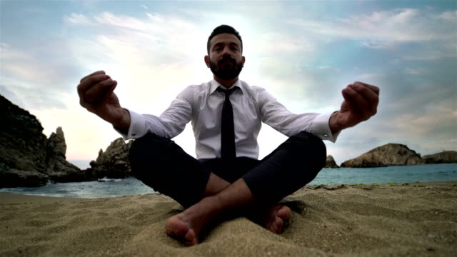 businessman doing yoga on the beach - 4k resolution - turkey middle east stock videos and b-roll footage