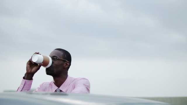 Businessman drinking from disposable cup