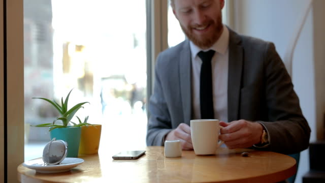 Businessman drinking tea with milk