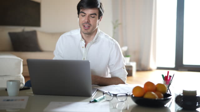 businessman during a video conference form his home - business casual stock videos & royalty-free footage