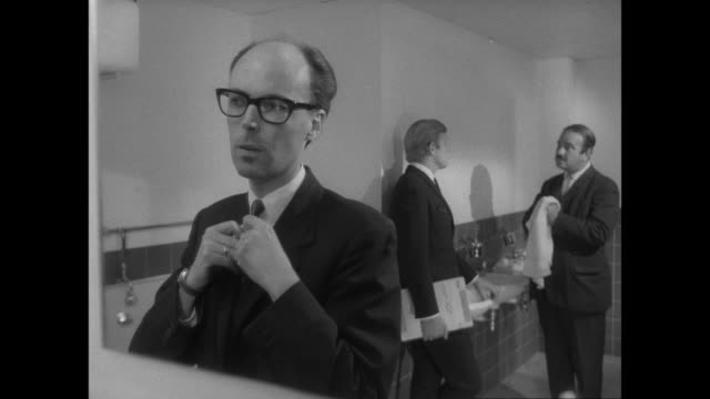 montage businessman eavesdropping in public bathroom / united kingdom - spy stock videos & royalty-free footage