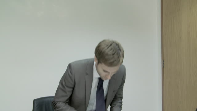 Businessman entering meeting room