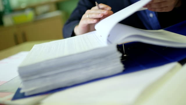 Businessman examining documents at desk