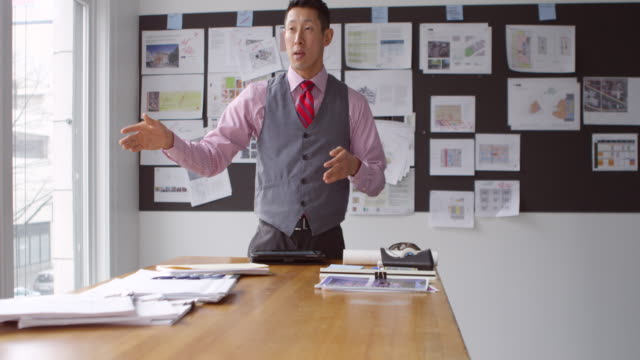 ms tu businessman explaining project in office conference room - deadline stock videos and b-roll footage