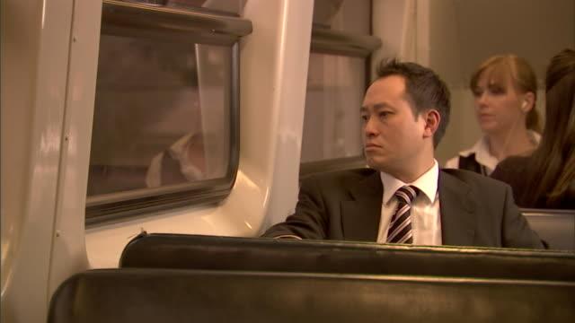 CU, Businessman falling asleep in train, Sydney, Australia