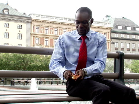 a businessman feeding birds stockholm sweden. - only mid adult men stock videos & royalty-free footage