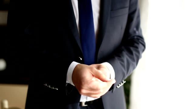 Businessman Fixing Cuff links