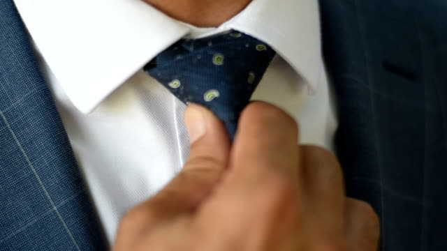 businessman fixing his tie - necktie stock videos & royalty-free footage