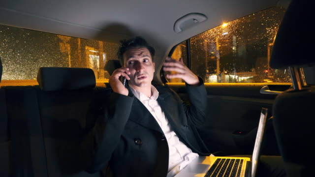 Businessman frustrated and angry talking on mobile phone.