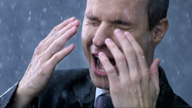 Businessman Get Drenched In The Rain (Super Slow Motion)