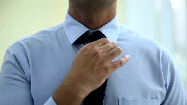 businessman getting dressed, delhi, india - shirt and tie stock-videos und b-roll-filmmaterial