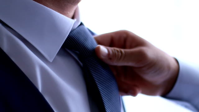 Businessman getting dressed
