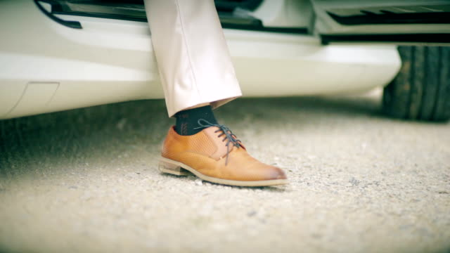 a businessman getting out of the car. - elegance stock videos & royalty-free footage