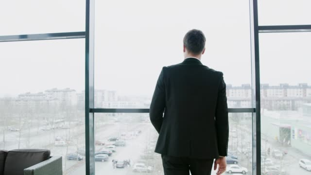 businessman getting up from desk in office, real time - desk stock videos & royalty-free footage