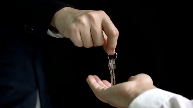 Businessman gives the keys