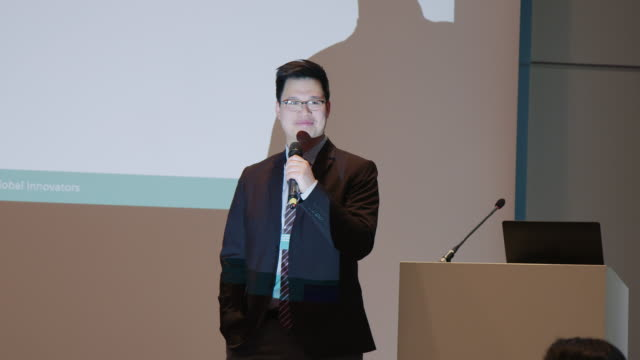 businessman giving presentation during conference - seminar stock videos & royalty-free footage