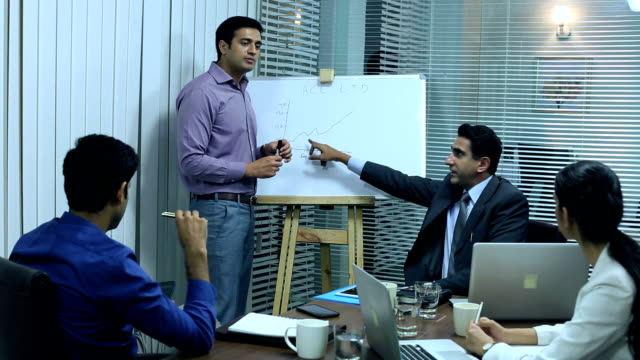 Businessman giving presentation in office, Delhi, India