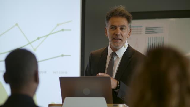 businessman giving presentation - explaining stock videos & royalty-free footage