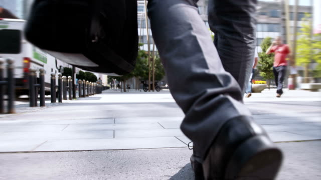 slo mo businessman going to work - human foot stock videos and b-roll footage