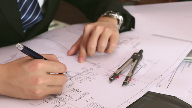 hd: businessman hand checking construction blueprint - pair of compasses stock videos & royalty-free footage
