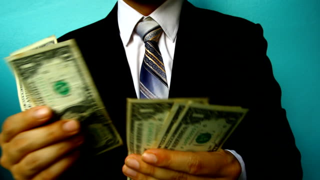 businessman hand hold money - excess stock videos & royalty-free footage
