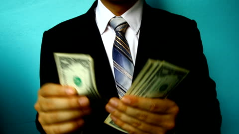businessman hand hold money - pocket stock videos & royalty-free footage